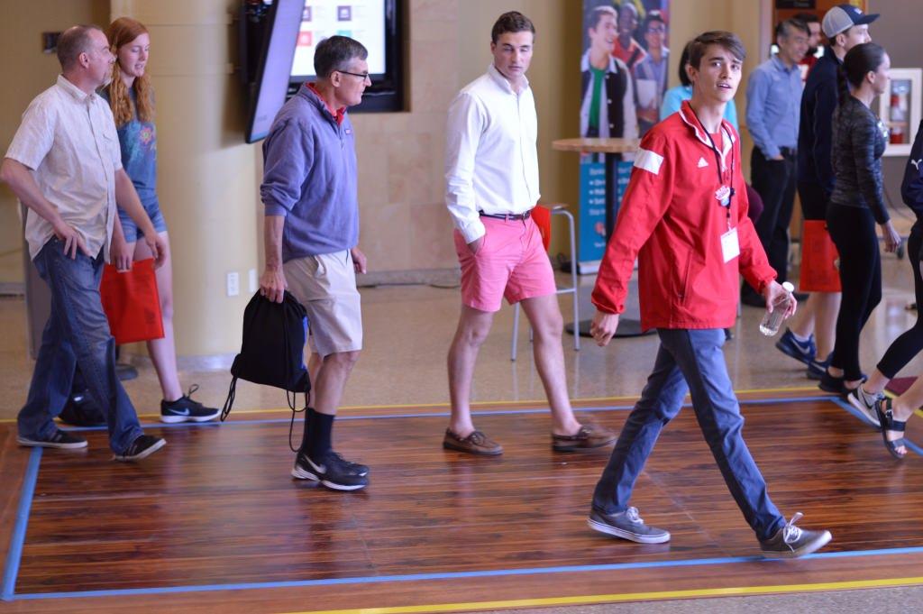 Photo: People walking across energy-harvesting floor