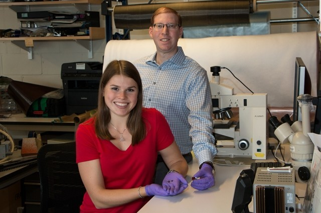 Research by MIT graduate student Ashley Kaiser (left) and postdoc Itai Stein shows that a small fraction of carbon nanotubes added to phenol-formaldehyde resin lowers the processing temperature needed to achieve the best combination of hardness and low density by 200 degrees Celsius.
