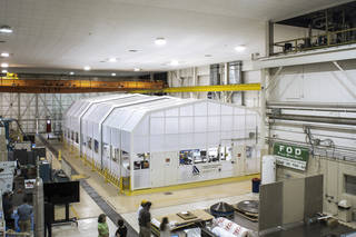 A view of the clean room from above, with white panels making the room look similar to a greenhouse.
