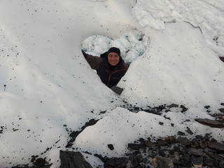 JPL's John Leichty looking through a heart-shape that formed in the ice on Matanuska Glacier