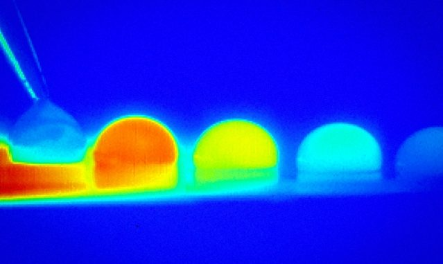In a time-lapse sequence, infrared imaging shows the temperature changes within a droplet of water as it moves across a treated silicon surface in response to temperature differences on that surface.