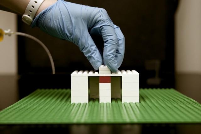 A researcher builds a platform for a system of fluidic bricks.