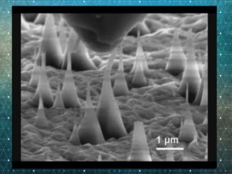 This scanning electron microscope image shows ultrafine diamond needles (cone shapes rising from bottom) being pushed on by a diamond tip (dark shape at top). These images reveal that the diamond needles can bend as much as 9 percent and still return to their original shape.