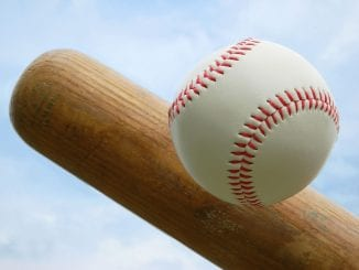 closeup of baseball and end of bat