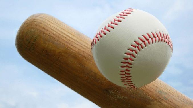 closeup of baseball and end of bat